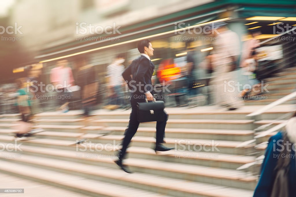 Businessman running on the street stock photo