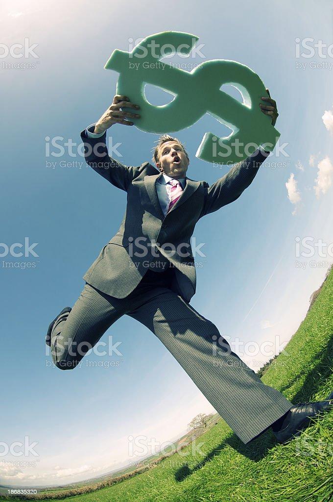 Businessman Runs Holding Big Dollar Sign royalty-free stock photo