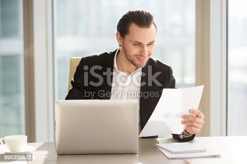 958531418 istock photo Businessman satisfied with company financial results 695359872