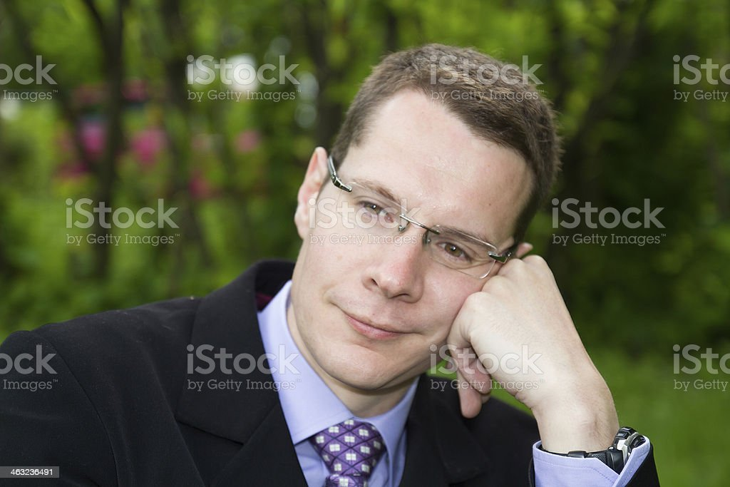 Businessman sat,withe a smile stock photo