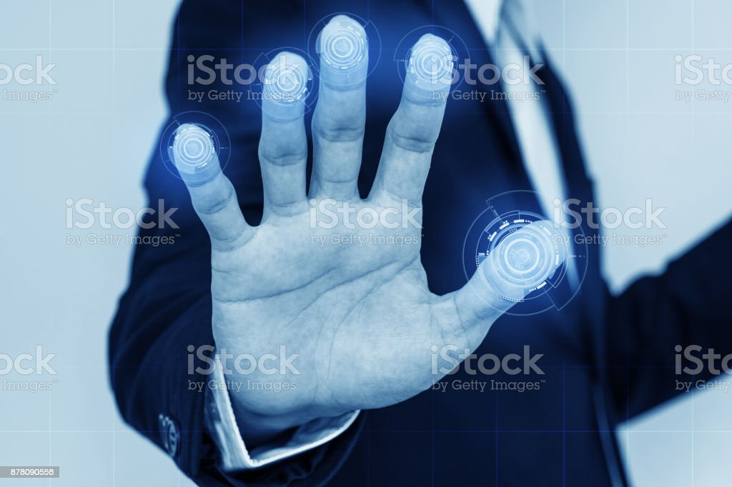 Businessman scan fingerprints on screen. security system technology concept stock photo