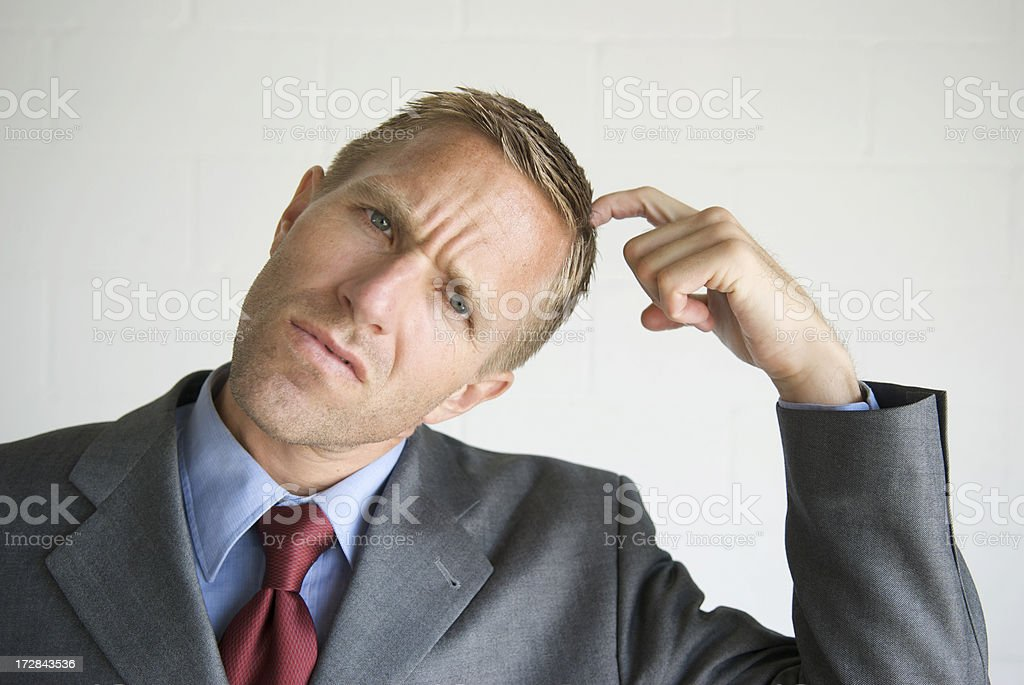 Businessman Scratching Head Looking Confused royalty-free stock photo