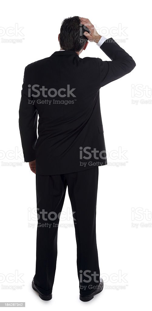 Businessman Scratching the Back of his Head stock photo