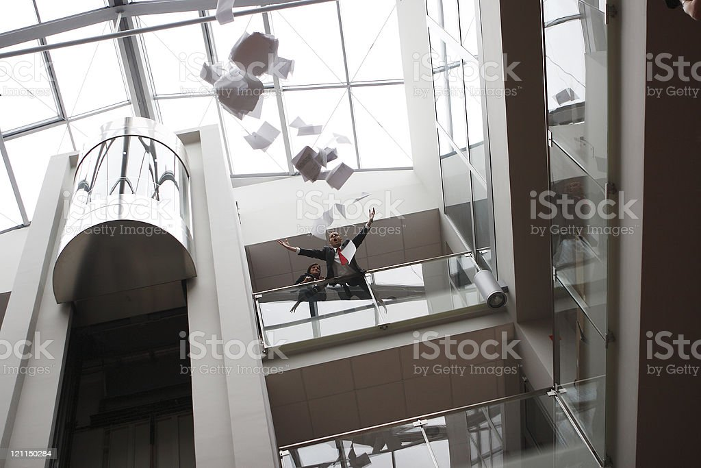 Businessman screaming after losing documents from a gallery stock photo