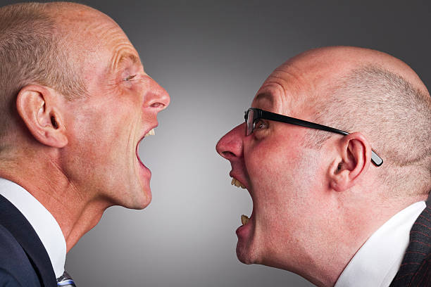 Businessman screaming at each other stock photo