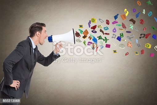 903659714 istock photo Businessman screaming into megaphone 855313568