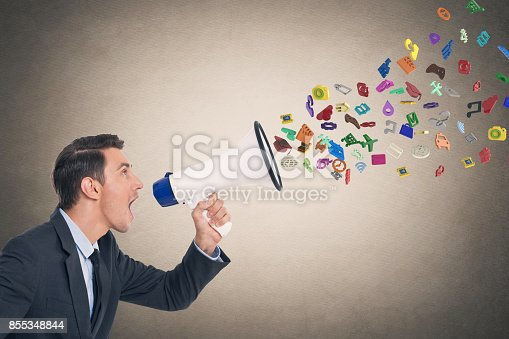 903659714 istock photo Businessman screaming into megaphone 855348844