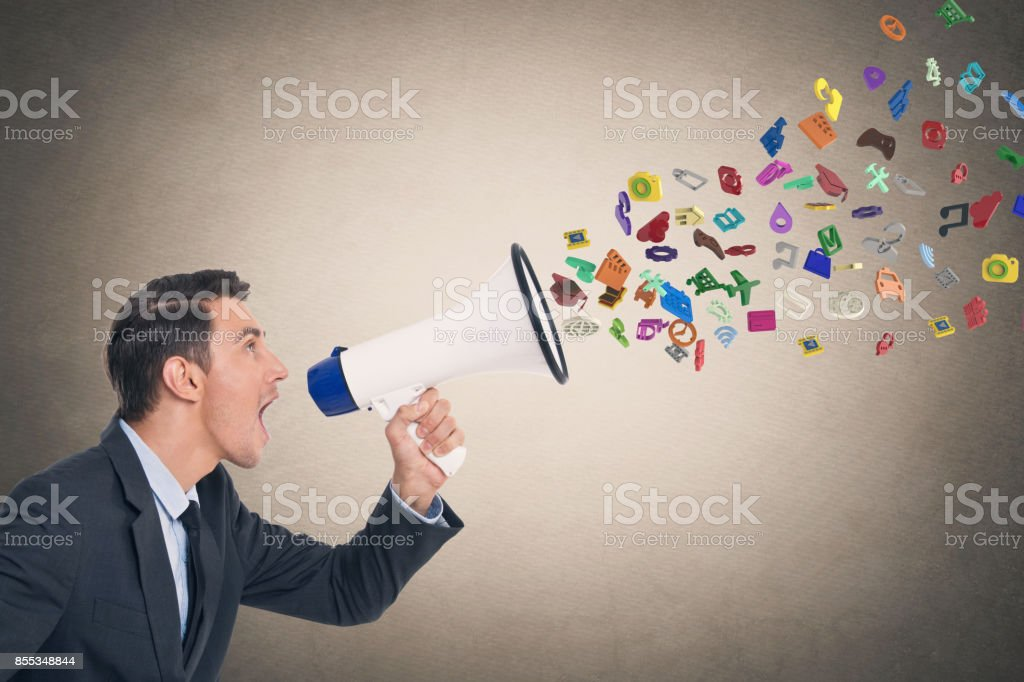 Businessman screaming into megaphone stock photo