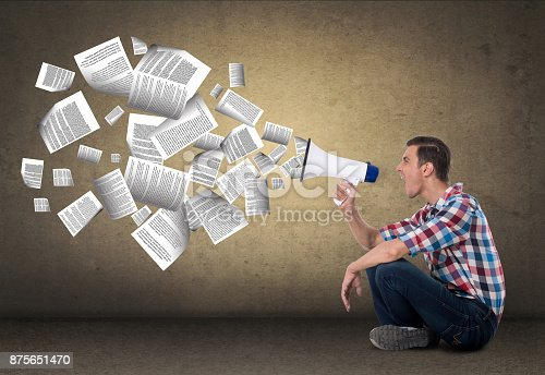 903659714istockphoto Businessman screaming on megaphone 875651470