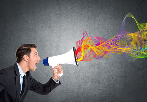 istock Businessman screaming on megaphone 895511144