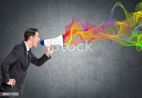 903659714istockphoto Businessman screaming on megaphone 895511202