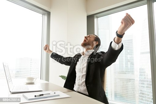 istock Businessman screaming with happiness in office 689425514