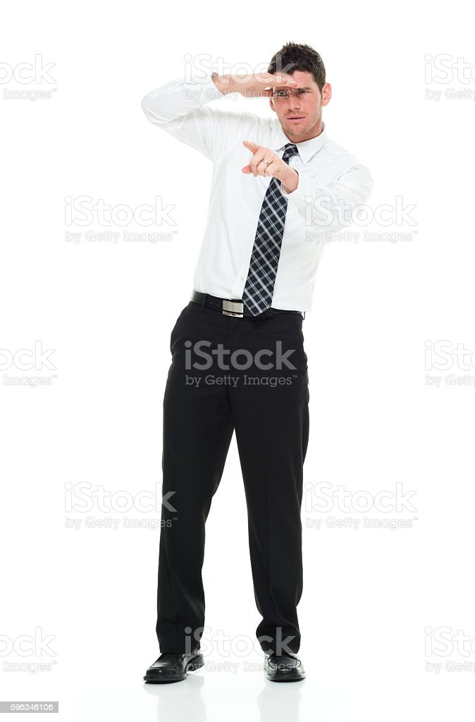 Businessman searching and pointing Lizenzfreies stock-foto