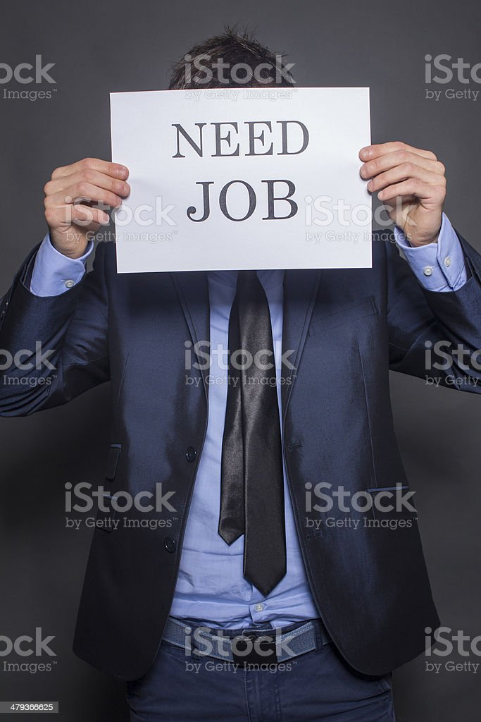 Businessman searching for a job stock photo