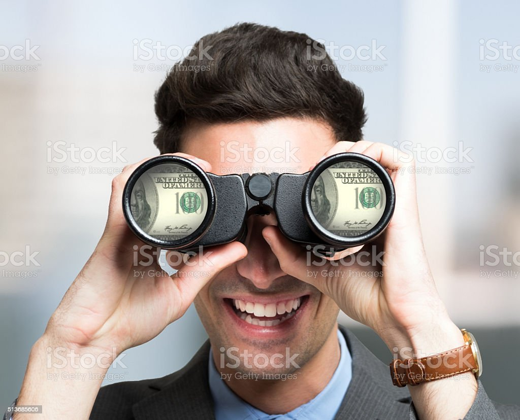 Businessman searching for money stock photo