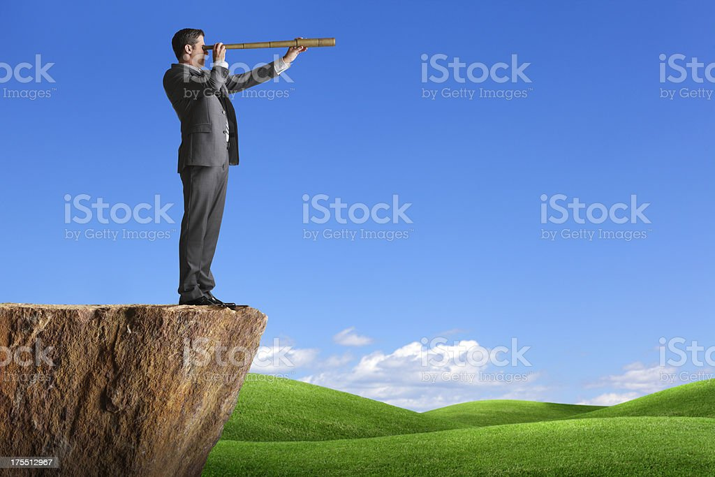 Businessman Searching Through Telescope stock photo