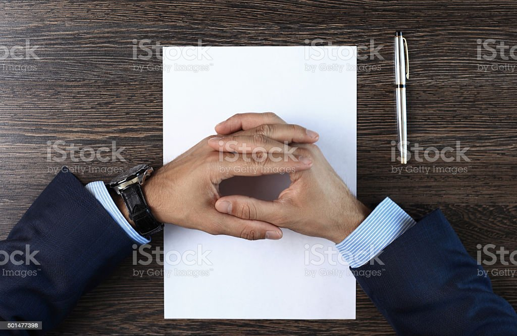 businessman seated at the table stock photo