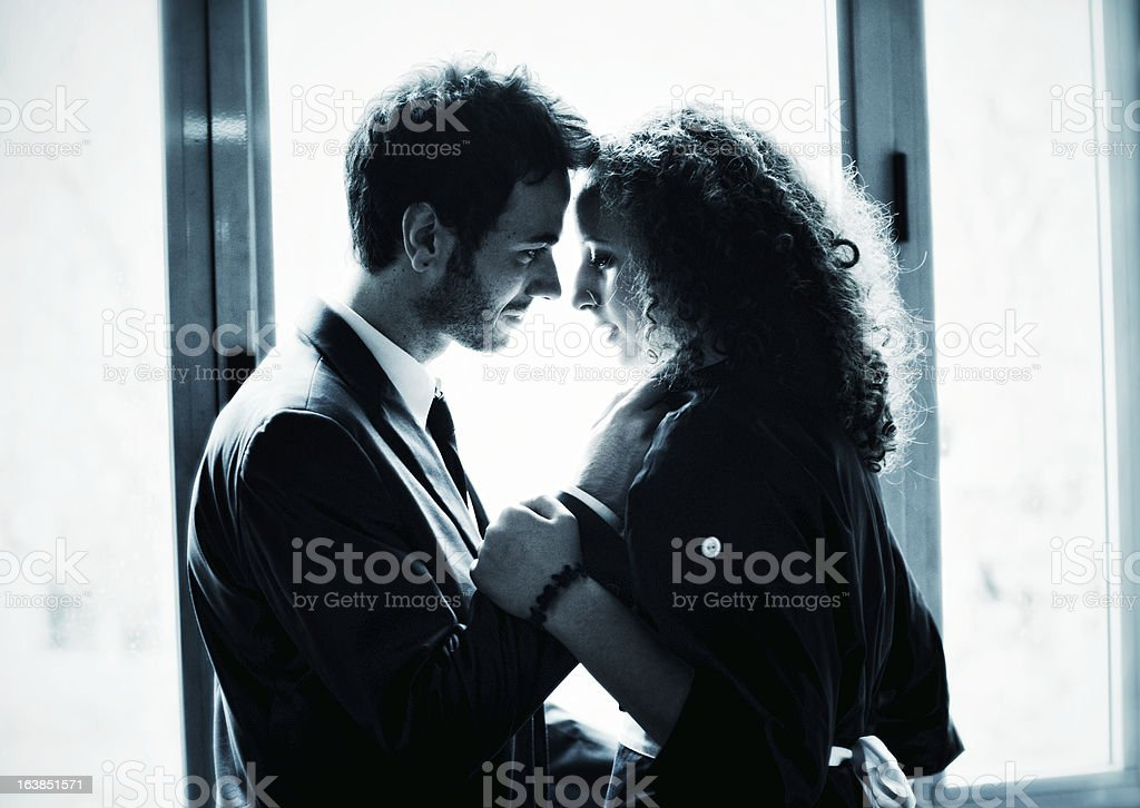 Businessman seduces young maid royalty-free stock photo