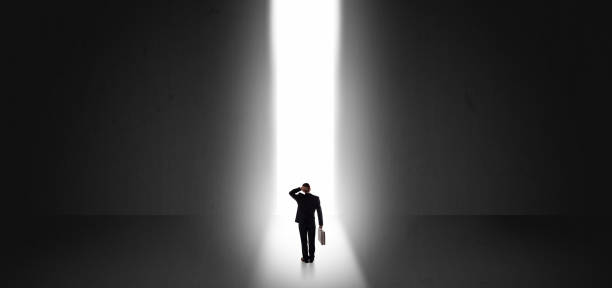 Businessman seeing the light at the end of something stock photo