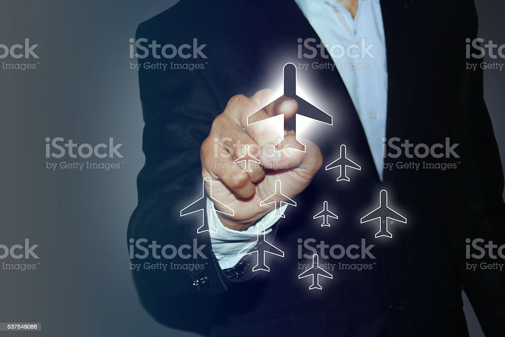 Businessman select a flight by touch screen airplane button stock photo