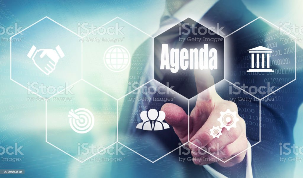 A businessman selecting a Agenda Concept button stock photo