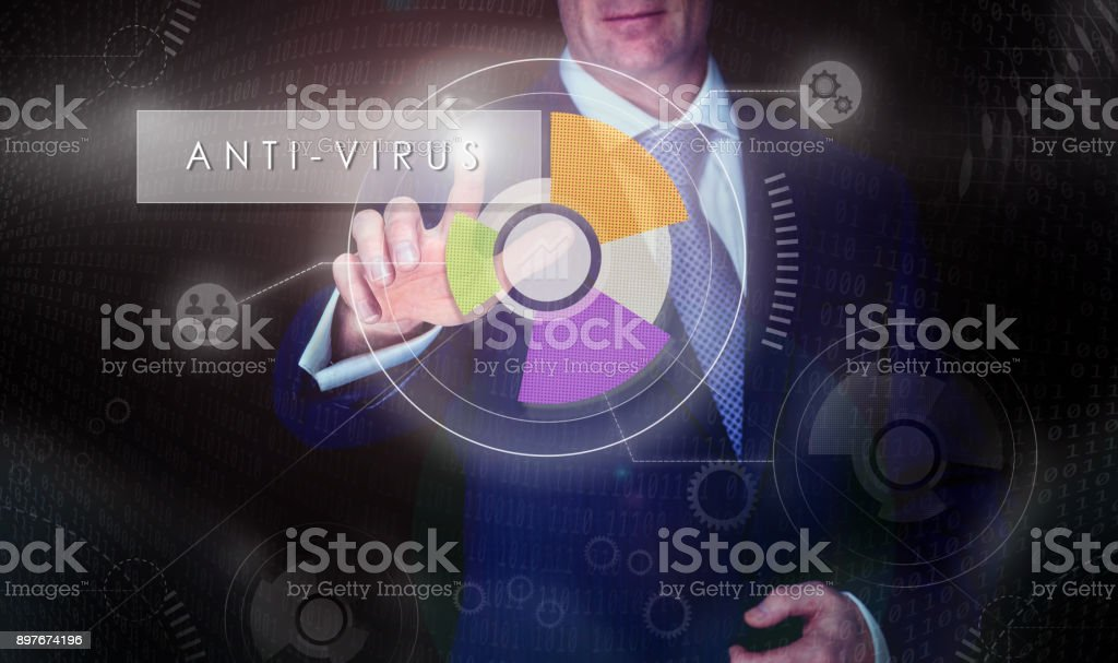 A businessman selecting a Anti-virus button on a computerised display screen. stock photo