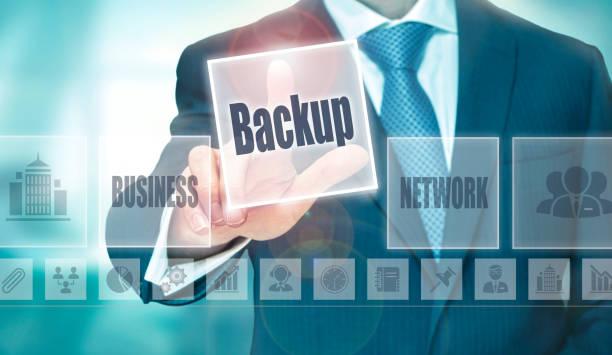 A businessman selecting a Backup Concept button stock photo