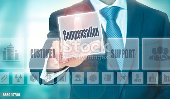 istock A businessman selecting a Compensation Concept button 886945788