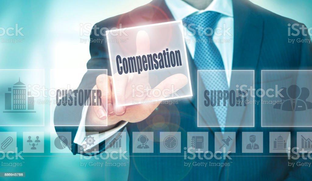 A businessman selecting a Compensation Concept button stock photo