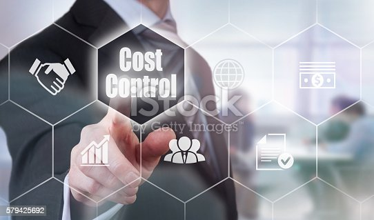 1197953545istockphoto Businessman selecting a Cost Control Concept button 579425692