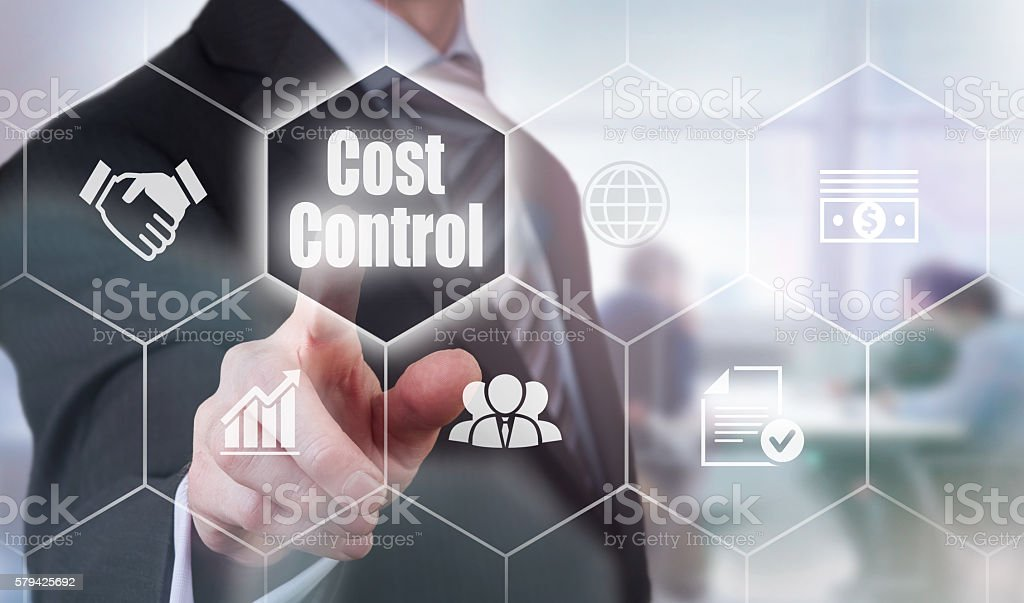 Businessman selecting a Cost Control Concept button stock photo