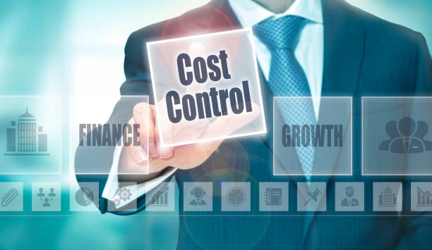 A businessman selecting a Cost Control Concept button stock photo