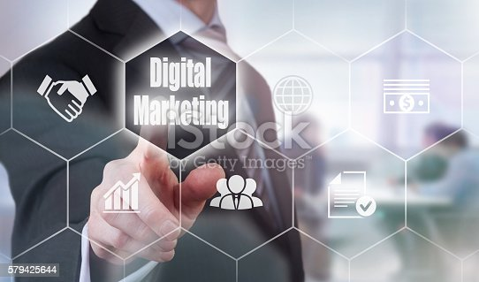 497982910 istock photo Businessman selecting a Digital Marketing Concept button 579425644