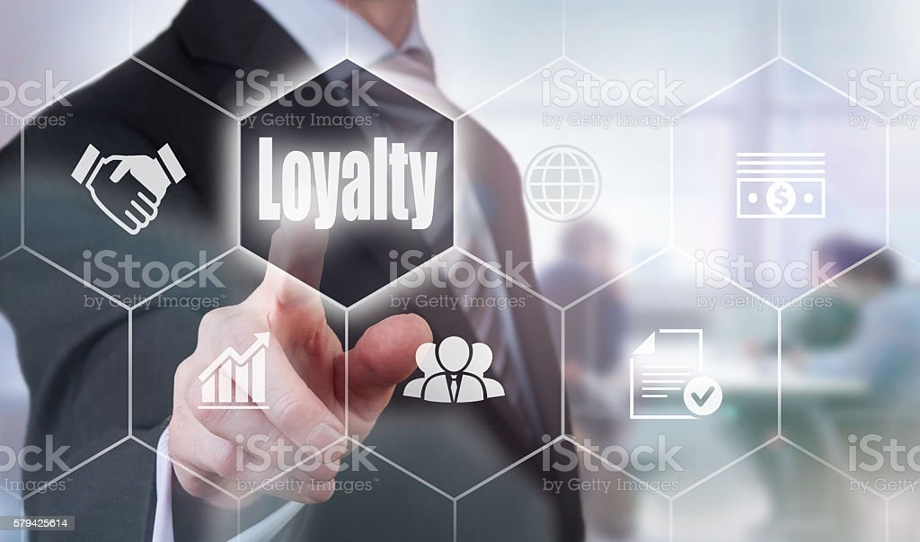 Businessman selecting a Loyalty Concept button stock photo