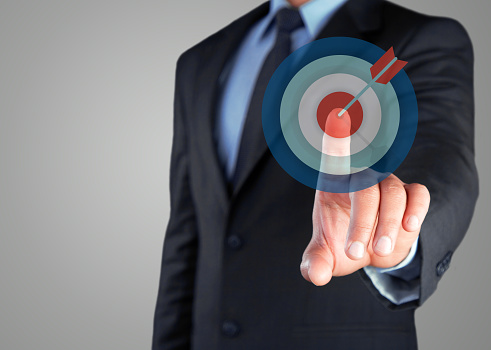 istock Businessman selecting dartboard button on virtual screen 627840754
