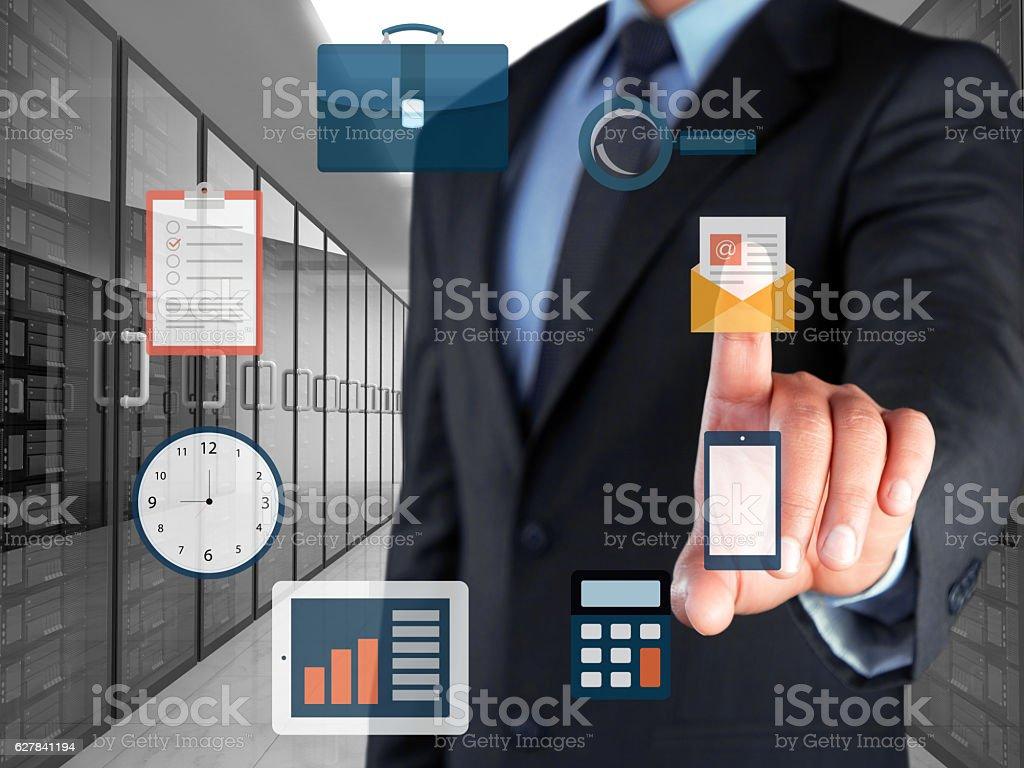 Businessman selecting e-mail marketing button on virtual screen stock photo