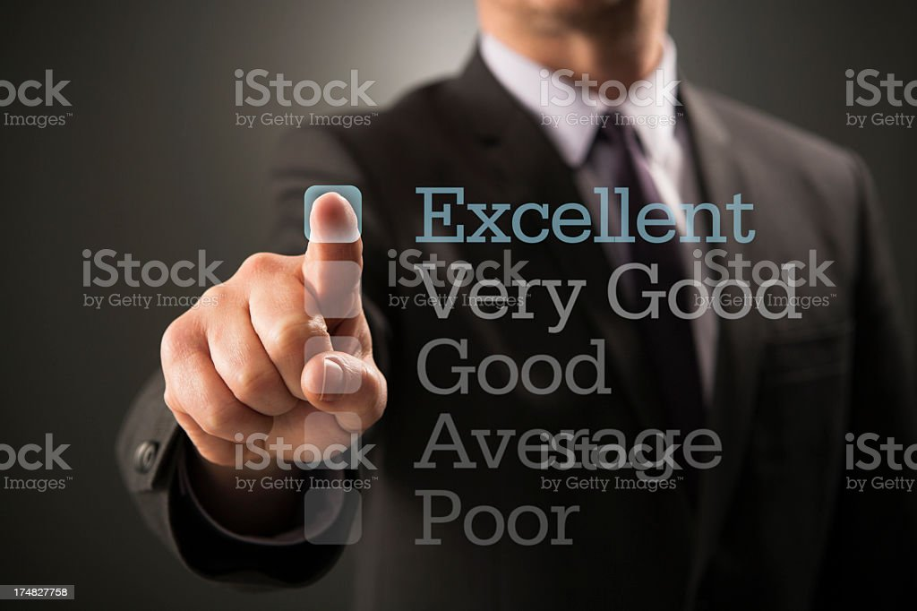 A businessman selecting excellent from a survey  royalty-free stock photo