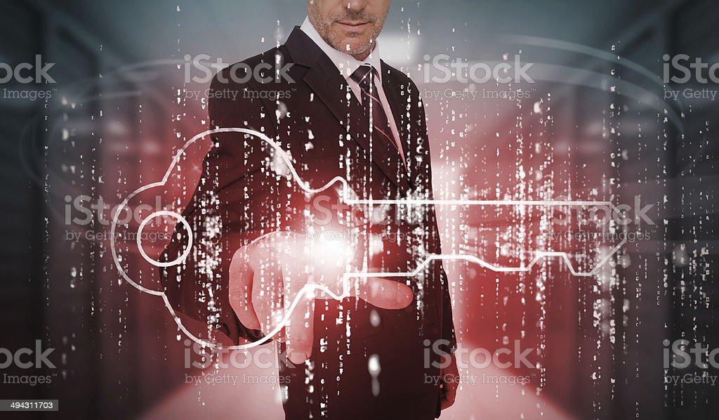 Businessman selecting futuristic key graphic stock photo