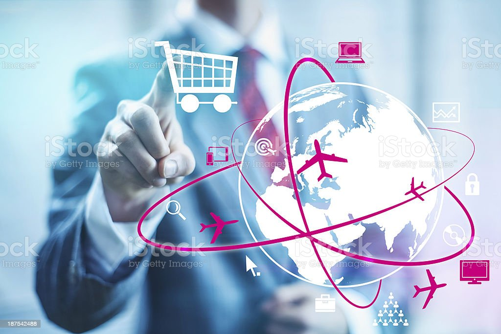 Businessman selecting online shopping cart stock photo