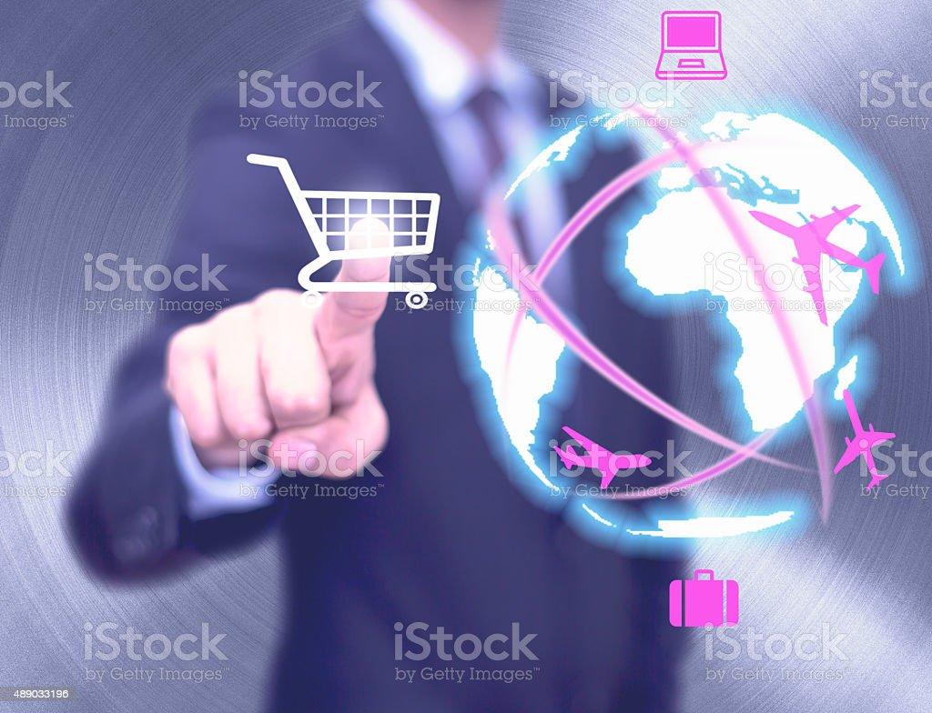 Businessman selecting online shopping cart stock photo