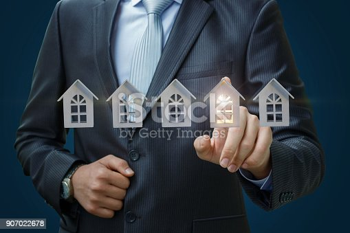 1023041738istockphoto Businessman selects a property. 907022678
