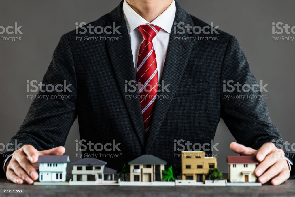 Businessman selling houses stock photo