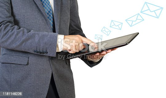 545576042 istock photo Businessman sending email with tablet pc 1181146226