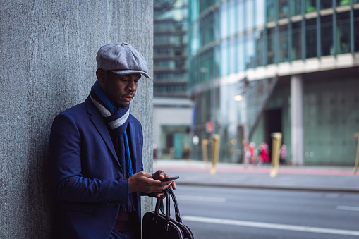 Businessman Sending Text Message In The City Stock Photo - Download Image Now