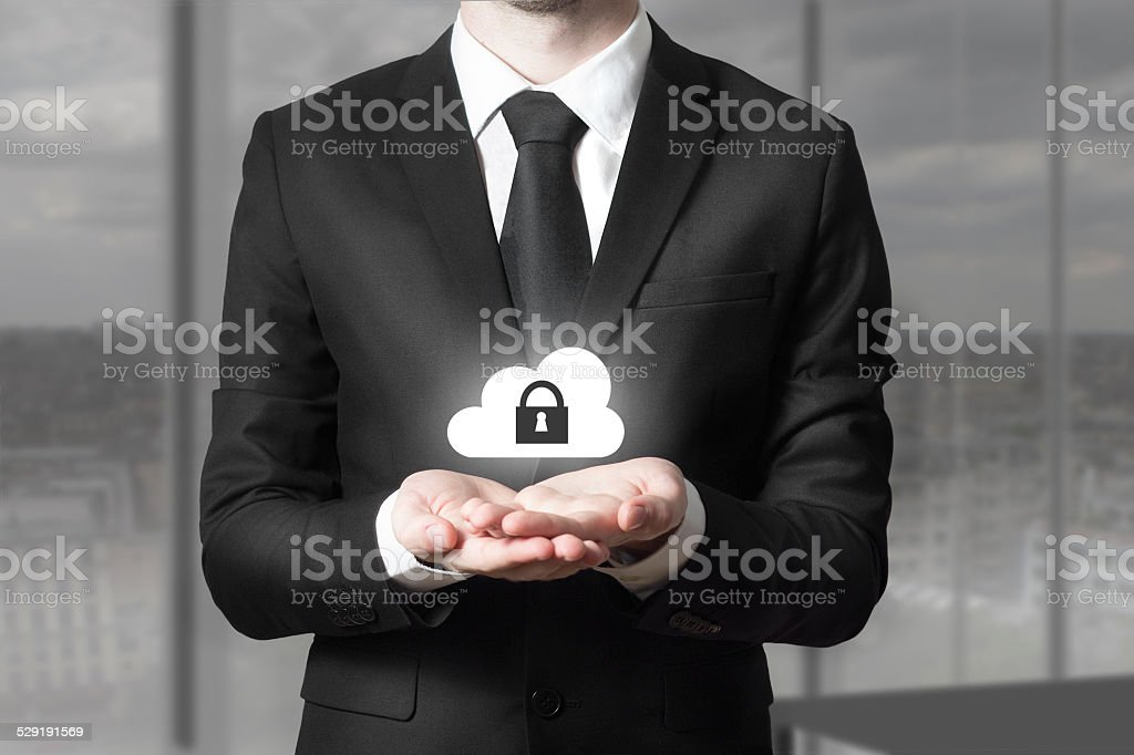 businessman serving gesture cloud security stock photo