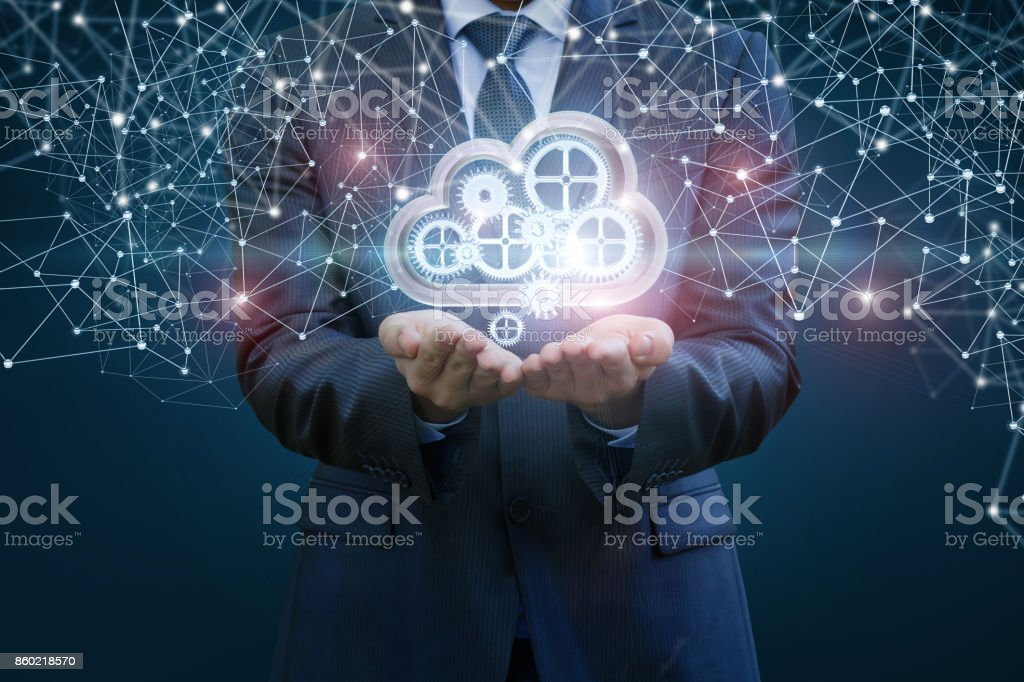 Businessman sets up the data cloud in the network. stock photo