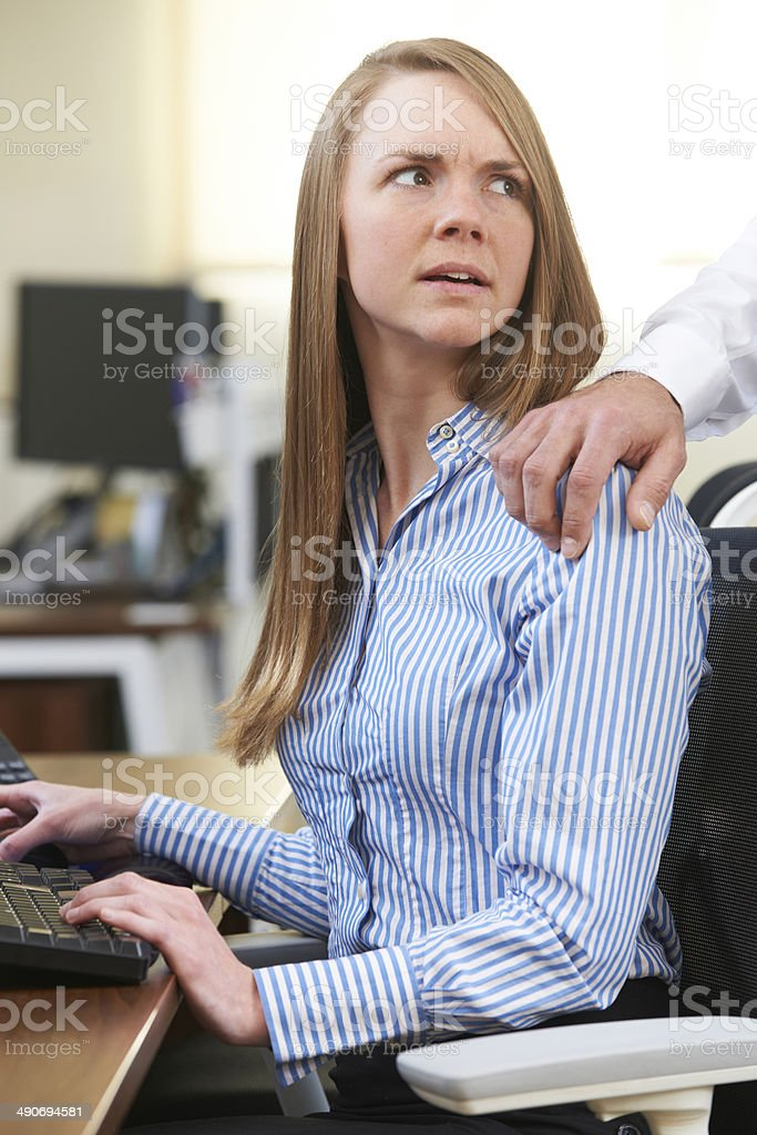 Businessman Sexually Harassing Female Colleague stock photo