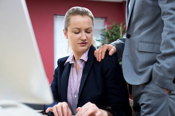 Businessman Sexually Harassing Female Colleague Businessman Sexually Harassing Female Colleague shock tactics stock pictures, royalty-free photos & images