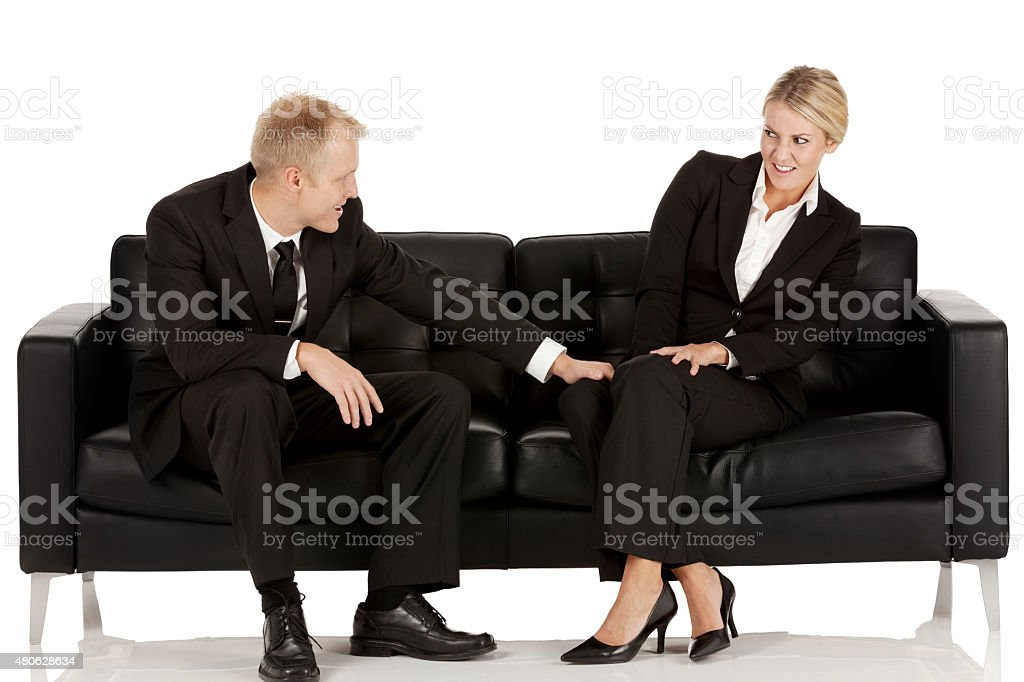 Businessman sexually harassing woman stock photo