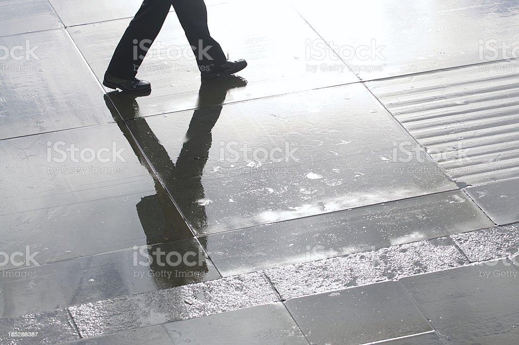 Businessman Shadow Reflects on Wet Stone Plaza stock photo